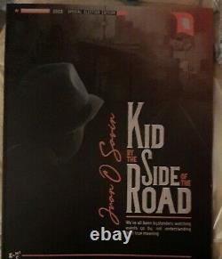 Kid by the side of the road. JFK JR EDITOR GEORGE MAGAZINE JUAN O SAVIN